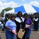 Chipo on right, Sandra (graduating), orphanage mother