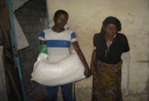 The late Mary Kupe receiving mealie Meal as part of support from Pearl Foundation