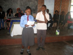 Two pupils giving a vote of thanks