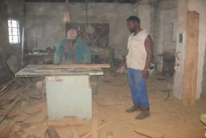 Gift Machaya (right) in the carpentry workshop with Mr Edson N'gandu